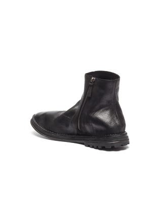- MARSÈLL - Distressed leather zip boots