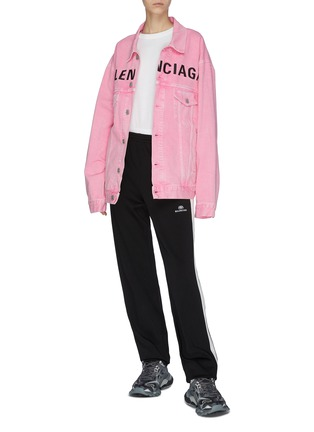 Moncler Puffer Gilet and Balenciaga Track sneakers worn by