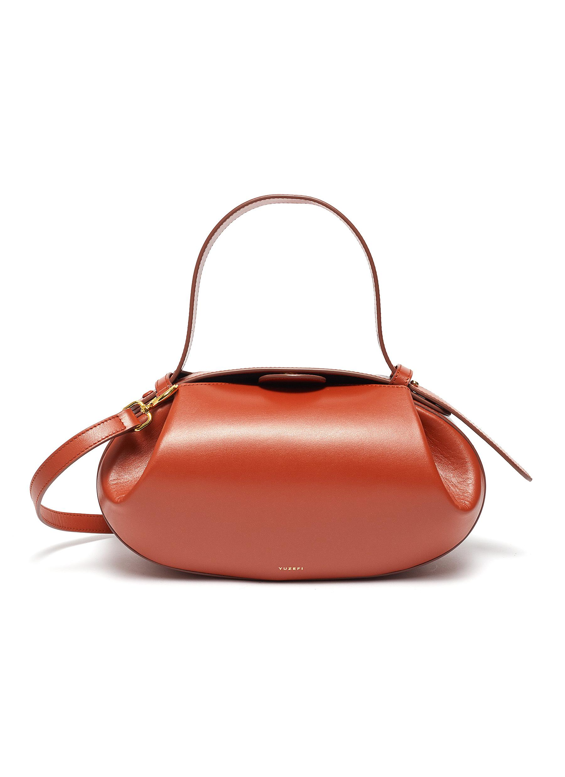 YUZEFI | 'Loaf' oval top handle leather bowling bag | Women