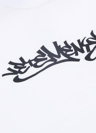 - VETEMENTS - Graffiti logo print T-shirt