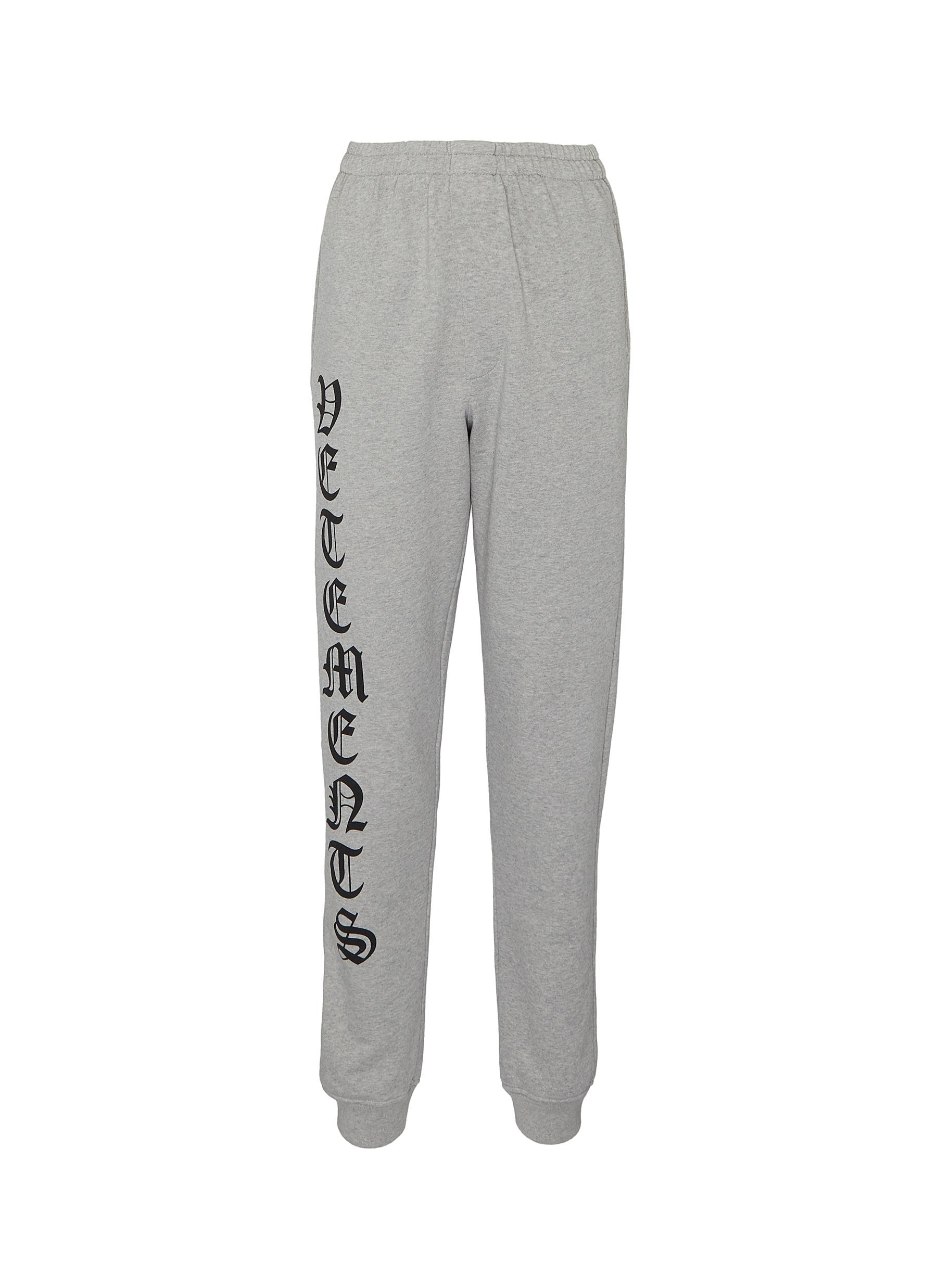 Buy Vetements Pants & Shorts 'Gothic' logo outseam sweatpants