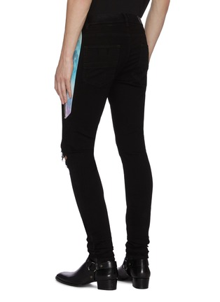 Back View - Click To Enlarge - AMIRI - Tie dye outseam ripped knee dark wash jeans