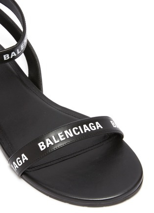 Detail View - Click To Enlarge - BALENCIAGA - Logo print strappy leather sandals