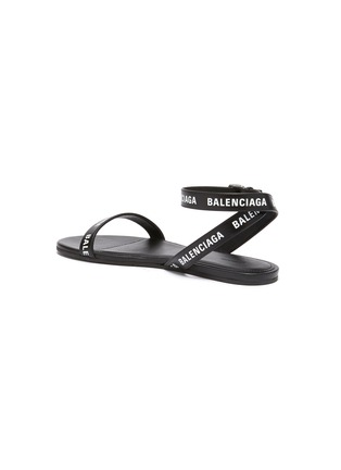 - BALENCIAGA - Logo print strappy leather sandals