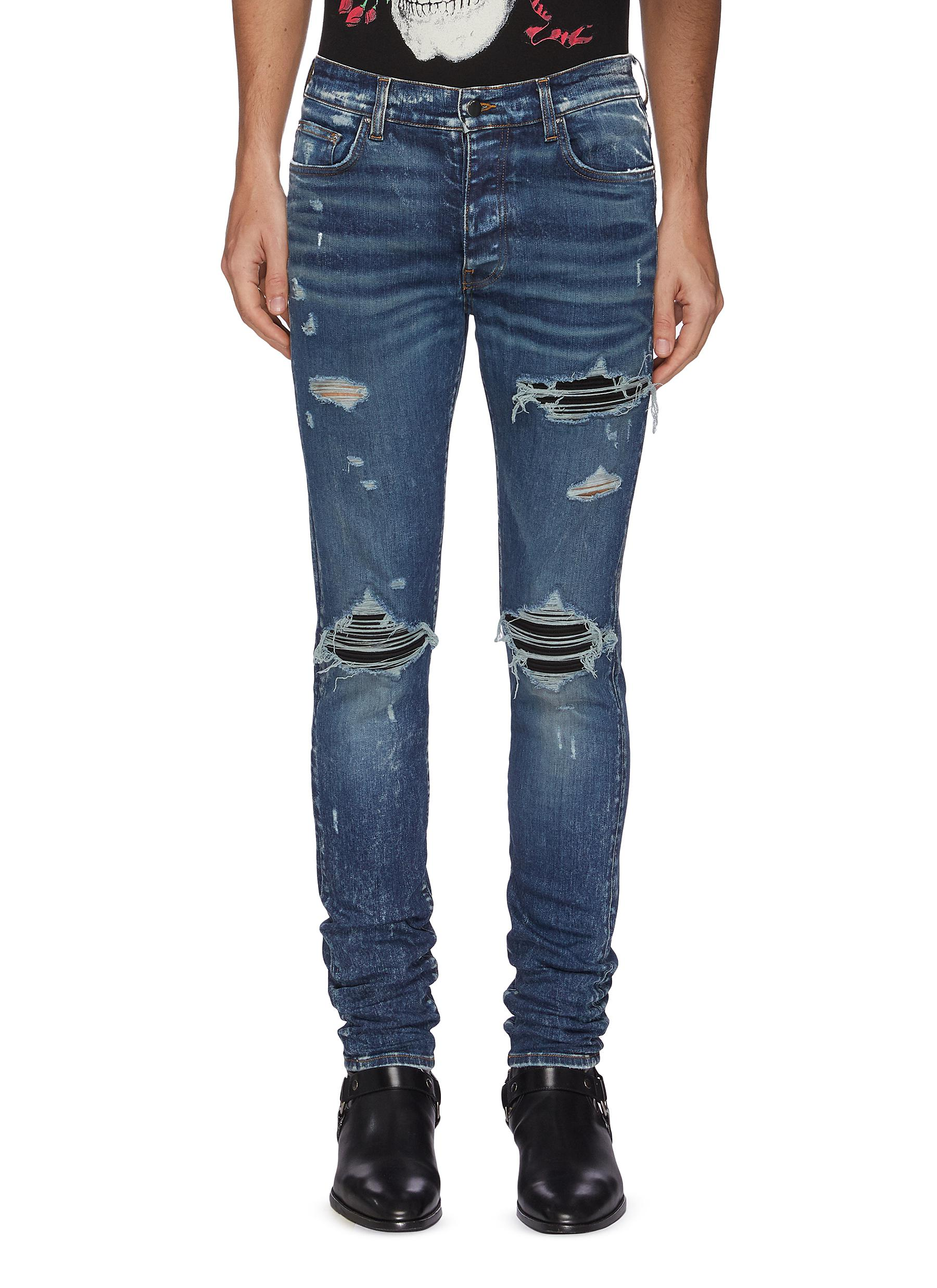 MX1' distressed jeans