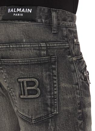 - BALMAIN - Zip pocket deconstructed jeans