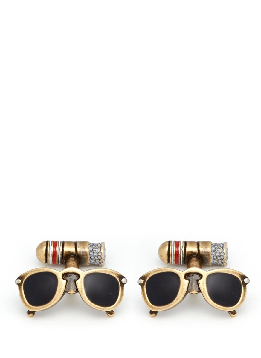 Retro sunglasses and cigar cufflinks