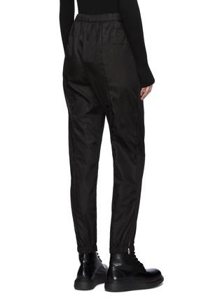 Back View - Click To Enlarge - PRADA - Logo Plaque Zipped Pocket Nylon Crop Jogger Pants