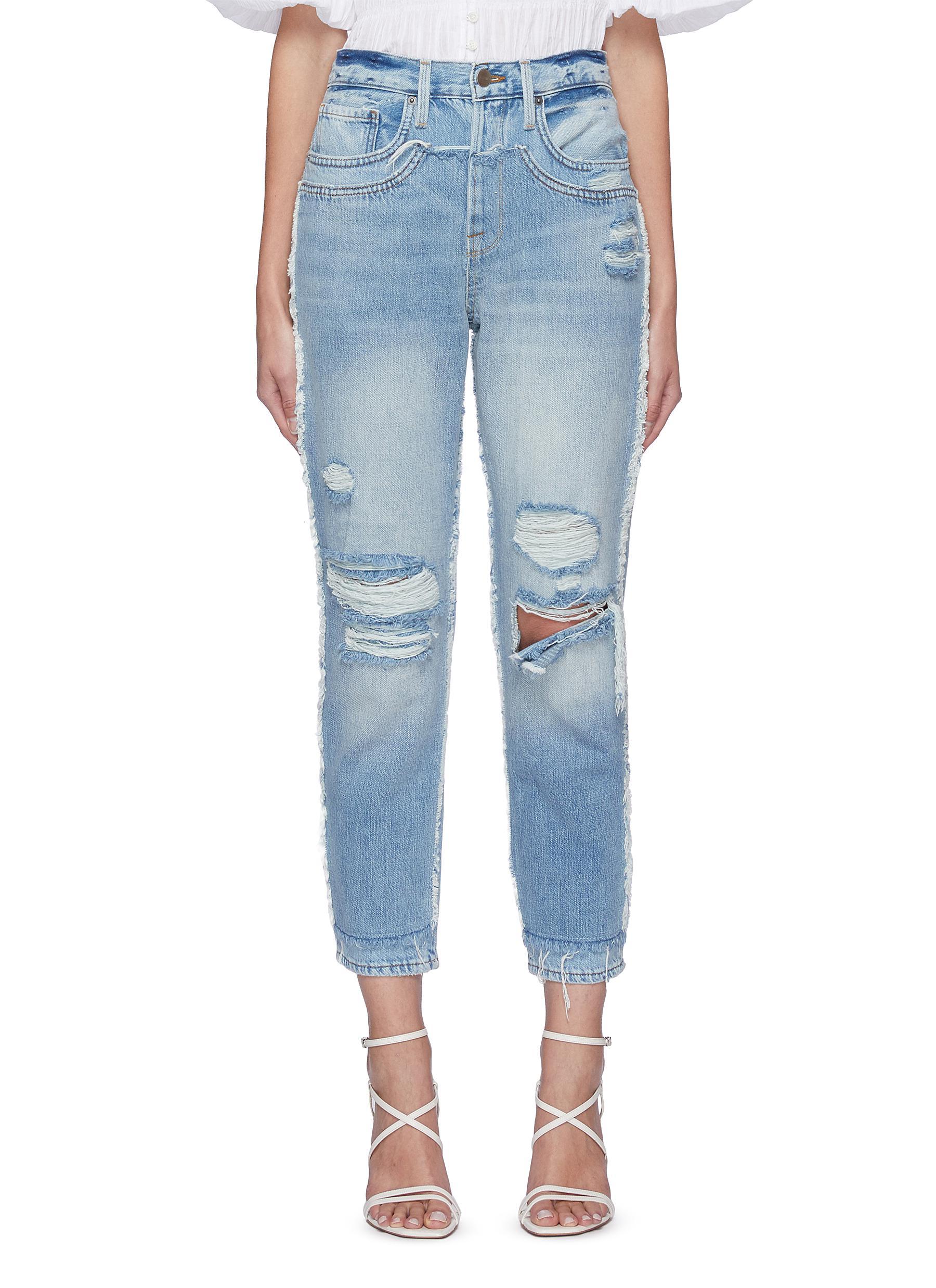 Fray hem distress light wash jeans