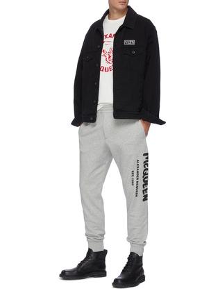 Figure View - Click To Enlarge - ALEXANDER MCQUEEN - Graffiti Logo Print Cotton Sweatpants