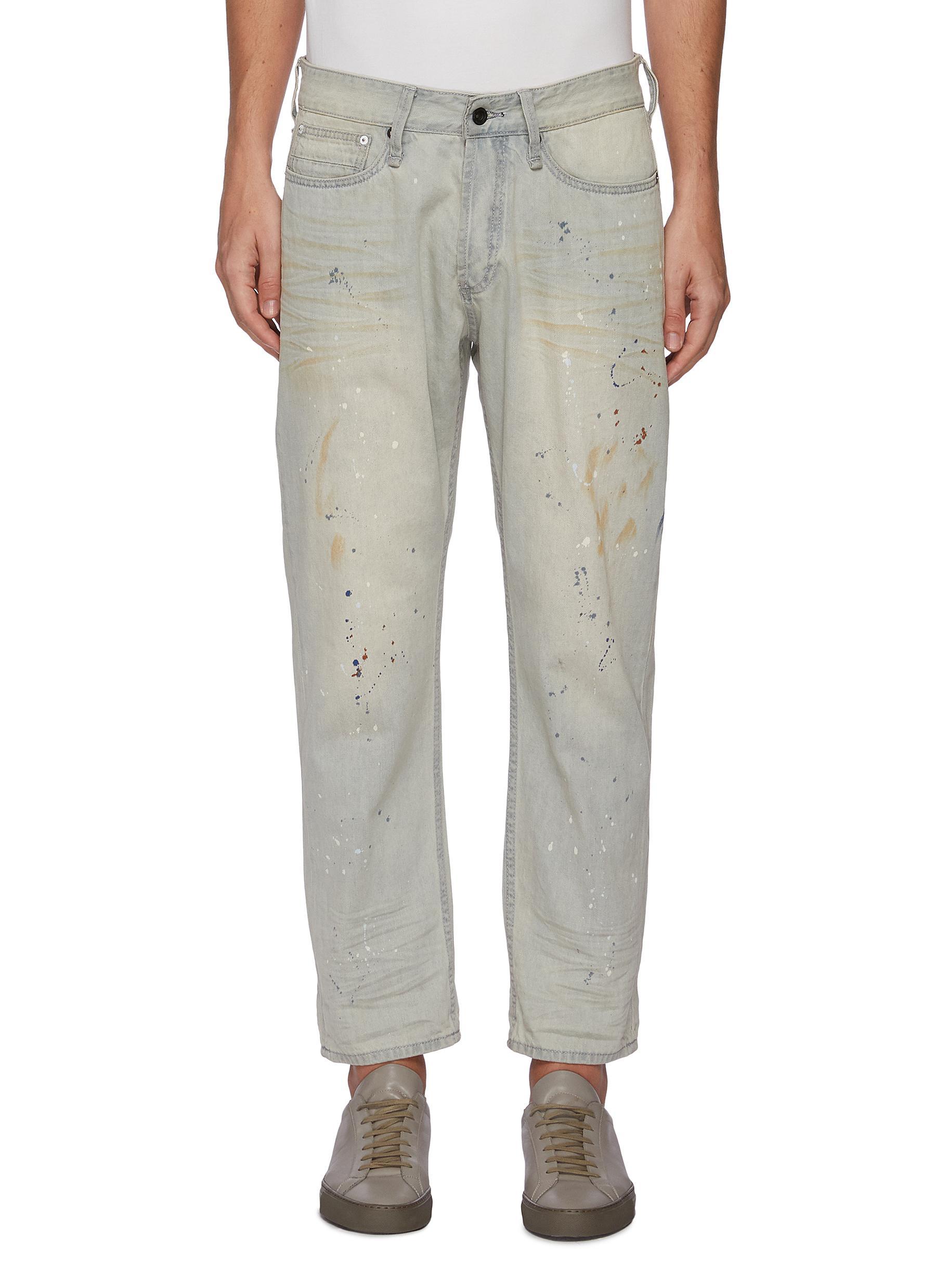 'Razor' paint splatter slim fit jeans