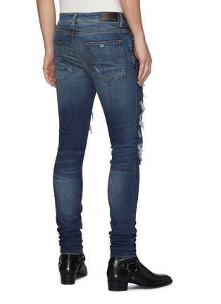Back View - Click To Enlarge - AMIRI - Thrasher' Ripped Ribbed Panel Slim Fit Washed Biker Jeans