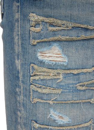 - AMIRI - Logo Appliqued Ripped Slim Fit Light Wash Jeans