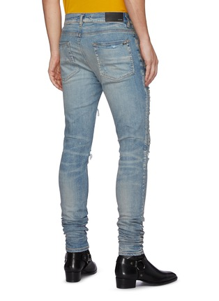 Back View - Click To Enlarge - AMIRI - Logo Appliqued Ripped Slim Fit Light Wash Jeans