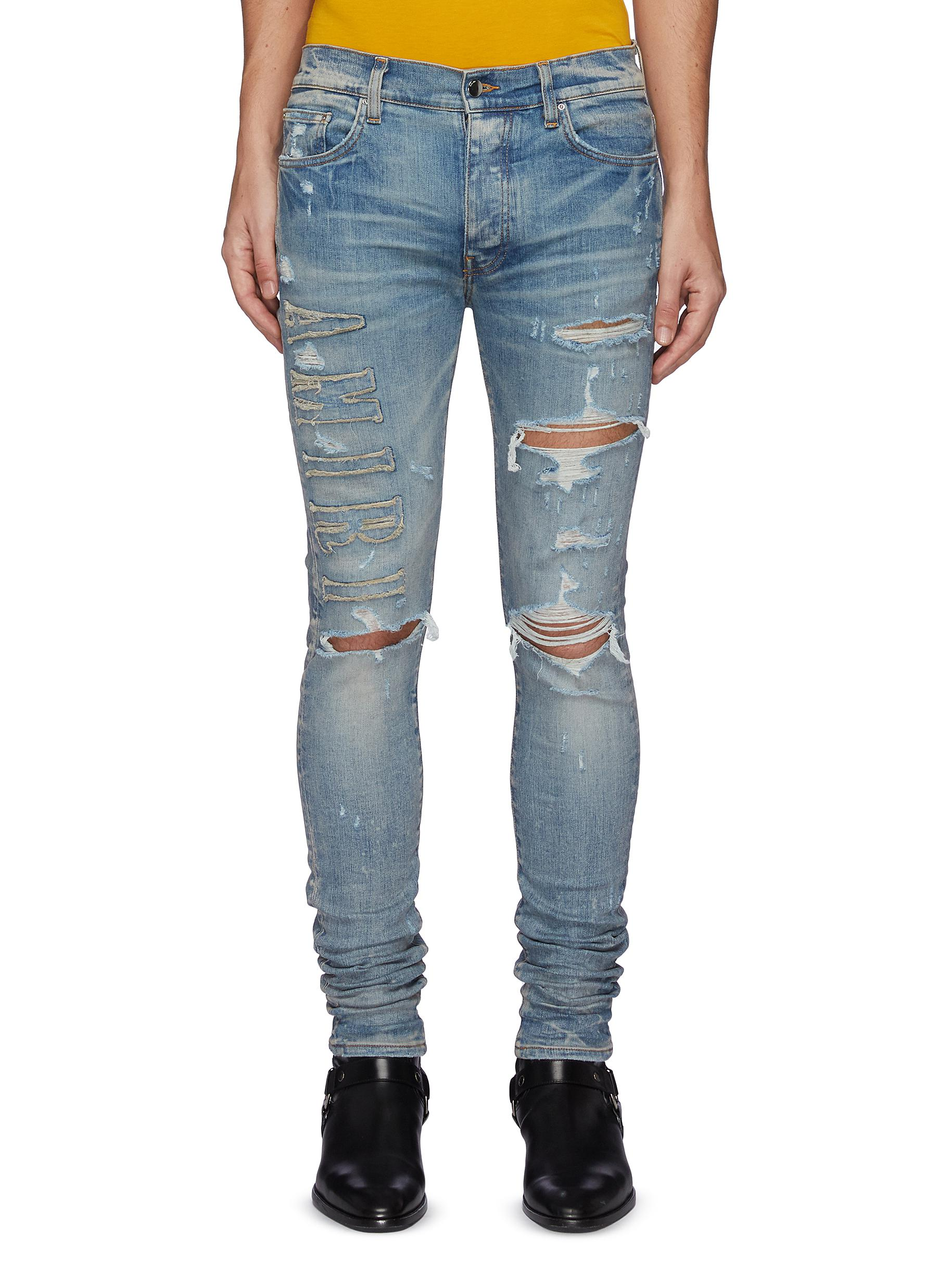 Logo Appliqued Ripped Slim Fit Light Wash Jeans