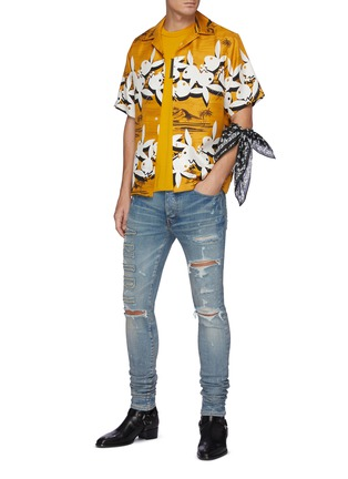 Figure View - Click To Enlarge - AMIRI - Logo Appliqued Ripped Slim Fit Light Wash Jeans