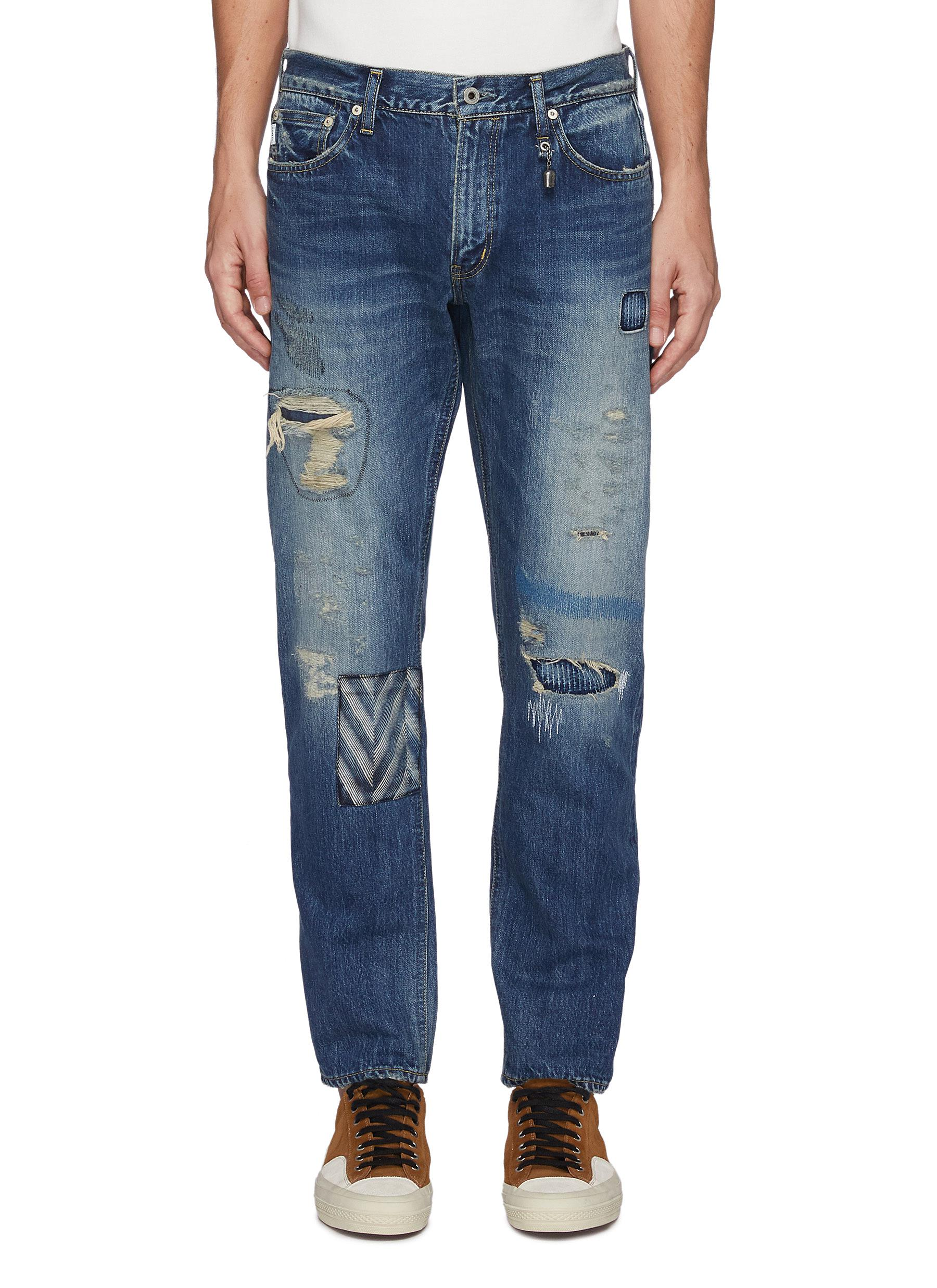 Ripped And Repaired Slim Fit Washed Jeans