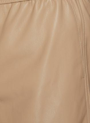 - NANUSHKA - Drawstring vegan leather shorts