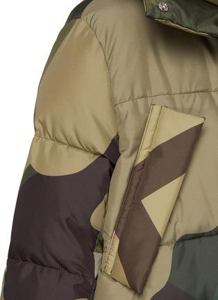 - SACAI - x KAWS Camouflage Print Puffer Jacket