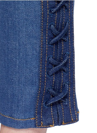 Detail View - Click To Enlarge - Alexander McQueen - Lace-up hem cropped kick flare jeans