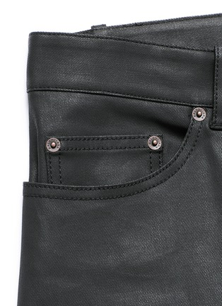 - Balenciaga - Slim fit coated denim jeans