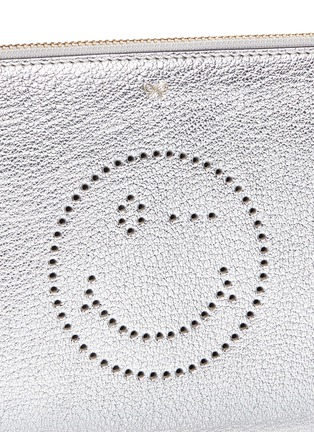 Detail View - Click To Enlarge - Anya Hindmarch - 'Wink' smiley perforated metallic leather zip pouch