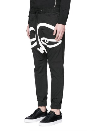 Front View - Click To Enlarge - Haculla - 'All Eyes On Me' print drop crotch sweatpants