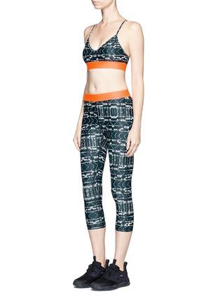 Figure View - Click To Enlarge - THE UPSIDE - 'Jungle Shibori NYC' print performance leggings