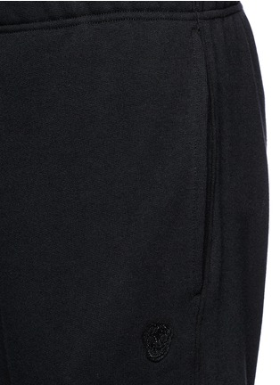 Detail View - Click To Enlarge - Alexander McQueen - Perforated leather patch jogging pants