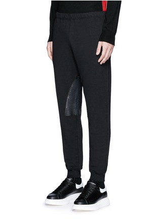 Front View - Click To Enlarge - Alexander McQueen - Perforated leather patch jogging pants