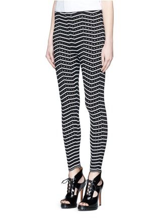Front View - Click To Enlarge - Alaïa - 'Fidji' bicolour perforated zigzag knit leggings