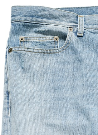 - SAINT LAURENT - Repaired knee patch distressed skinny jeans