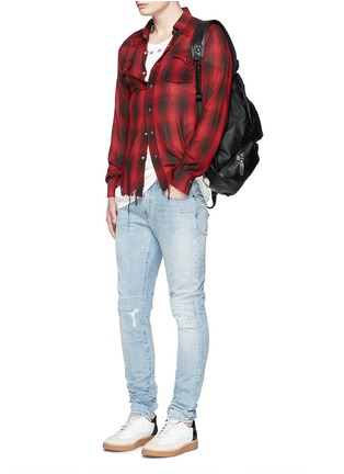 Figure View - Click To Enlarge - SAINT LAURENT - Repaired knee patch distressed skinny jeans
